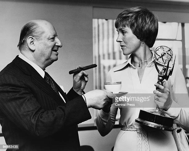 British showbusiness impresario Sir Lew Grade hands a cup of tea to actress and singer Julie Andrews at ATV House London 6th June 1973 Andrews is...