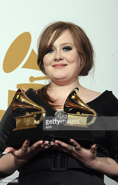 British singer Adele holds the Grammy awards for the Best New Artist and Best Female Pop Vocal Performance for 'Chasing Pavements during the 51st...