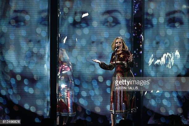 British singer Adele performs on stage during the BRIT Awards 2016 in London on February 24 2016 / AFP / JUSTIN TALLIS / RESTRICTED TO EDITORIAL USE...