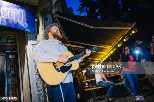 British singer Alex Clare performs an acoustic set during a secret concert on the streets of Berlin on September 15 2014 in Berlin Germany