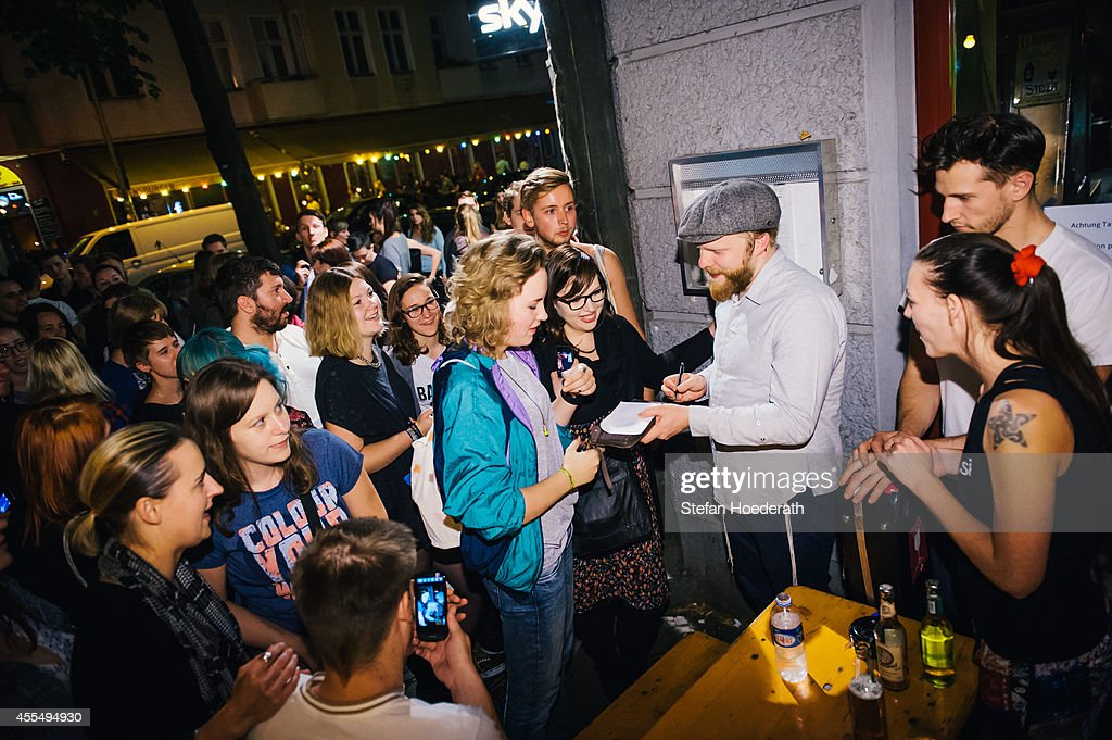 British singer Alex Clare signs autographs after performinh a secret concert on the streets of Berlin on September 15 2014 in Berlin Germany