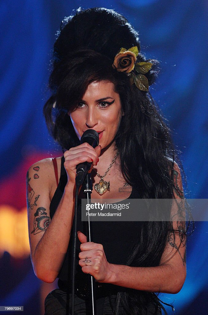 British singer <a gi-track='captionPersonalityLinkClicked' href=/galleries/search?phrase=Amy+Winehouse&family=editorial&specificpeople=201684 ng-click='$event.stopPropagation()'>Amy Winehouse</a> performs at The Riverside Studios for the 50th Grammy Awards ceremony via video link on February 10, 2008 in London, England.