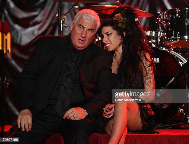 British singer Amy Winehouse sits with her father Mitch as they await news of her Grammy Award at The Riverside Studios for the 50th Grammy Awards...