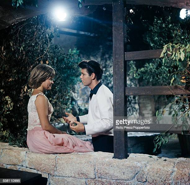 British singer and actor Cliff Richard and American singer and actress Lauri Peters pictured together in a scene from the film Summer Holiday at...