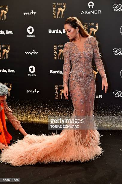 British singer and actress Rita Ora poses on the red carpet upon her arrival for the 2017 BAMBI awards ceremony on November 16 2017 at the Stage...