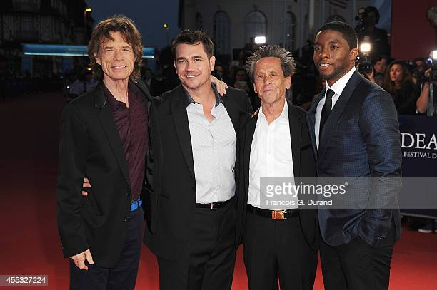 British singer and coproducer Mick Jagger US film director Tate Taylor US film producer Brian Grazer and US actor Chadwick Boseman attend the 'Get On...