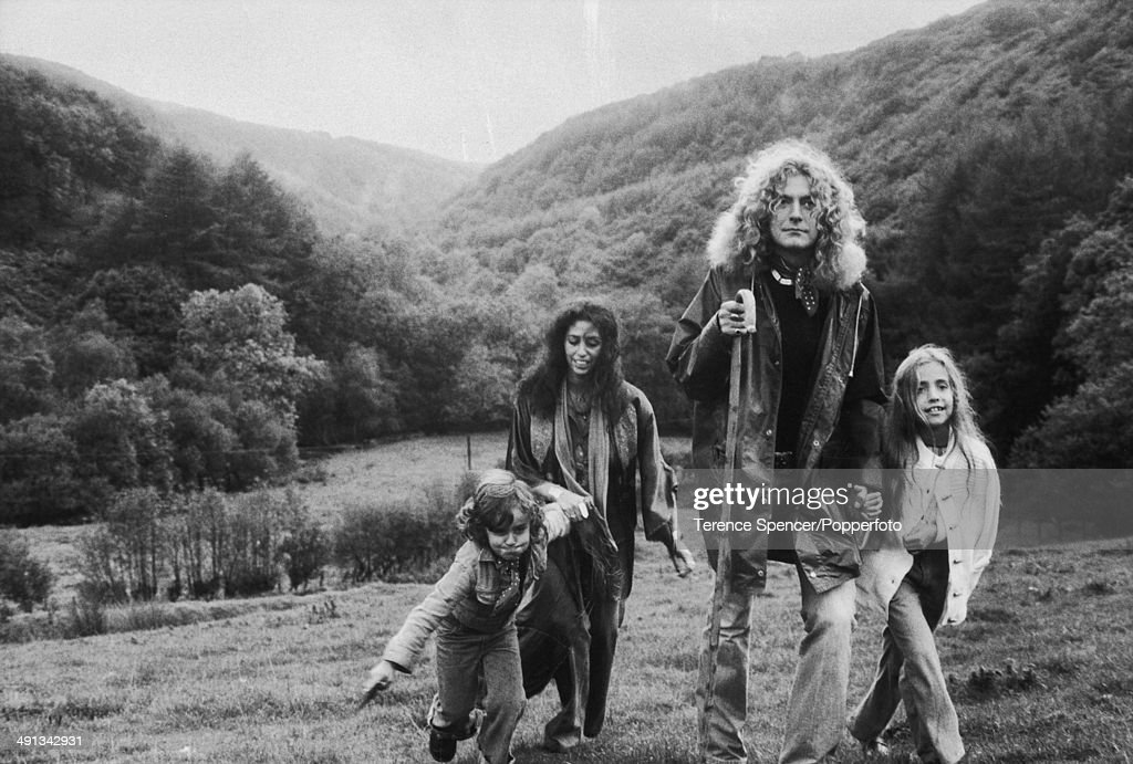 British musician <a gi-track='captionPersonalityLinkClicked' href=/galleries/search?phrase=Robert+Plant&family=editorial&specificpeople=211368 ng-click='$event.stopPropagation()'>Robert Plant</a>, of the group Led Zeppelin, walk in a field with his family near their home, Wales, October 15, 1976. Pictured are Plant (center right), his wife, Maureen Wilson (center left), and their children, Karac (1972 - 1977) (left) and Carmen.