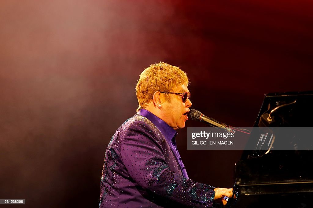 British singer and musician Sir Elton John performs at the 'Yarkon' park in Tel Aviv on May 26, 2016. / AFP / Gil Cohen-Magen