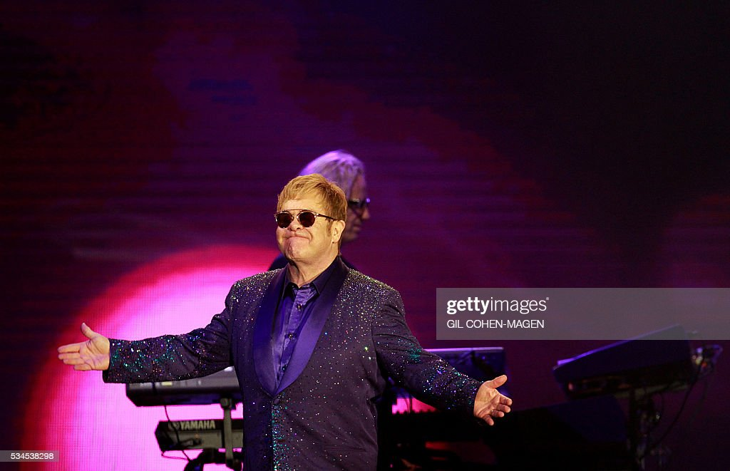British singer and musician Sir Elton John performs at the 'Yarkon' park in of Tel Aviv on May 26, 2016. / AFP / Gil Cohen-Magen