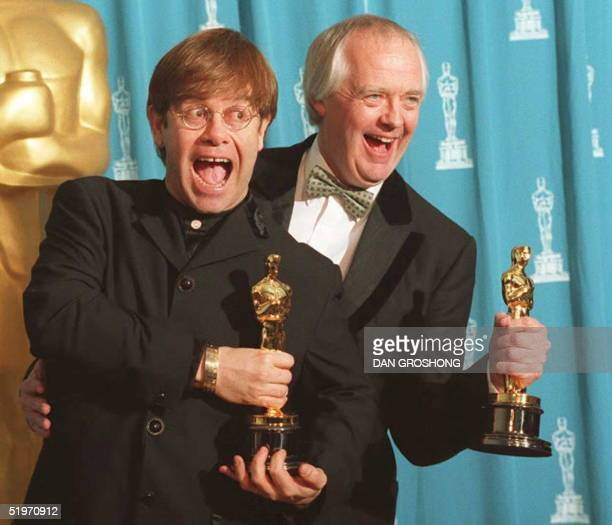 British singer and songwriter Elton John poses with partner Tim Rice 27 March at the 67th annual Academy Awards in Los Angeles John and Rice won...