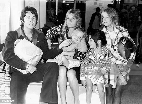 British singer and songwriter Paul McCartney poses with his wife Linda and their daughters left to right Stella Mary and Heather at Heathrow Airport...