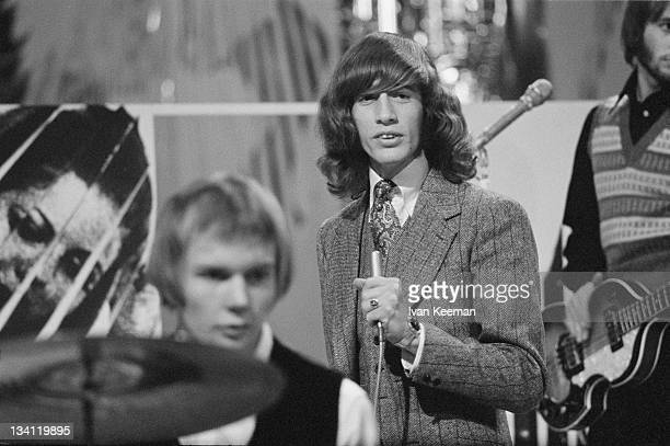 British singer and songwriter Robin Gibb performing with the Bee Gees on the BBC music programme 'Top Of The Pops' London 1967 With him are drummer...