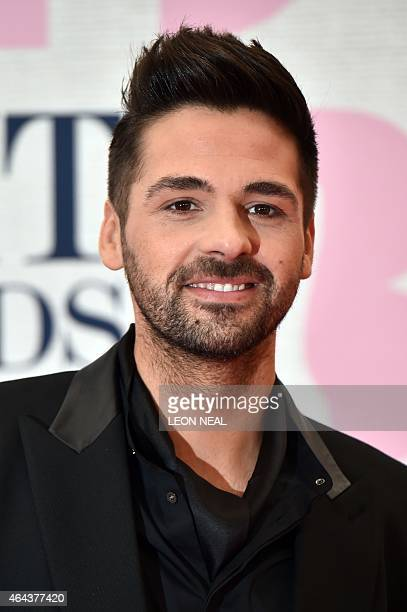 British singer Ben Haenow poses on the red carpet to attend the BRIT Awards 2015 in London on February 25 2015 PERFORMER