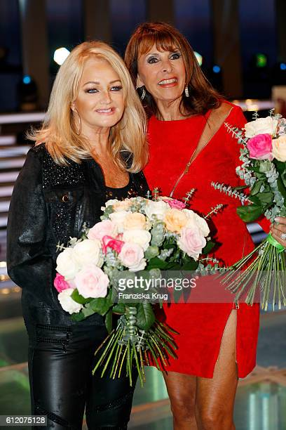 British singer Bonnie Tyler and singer Ireen Sheer during the tv show 'Willkommen bei Carmen Nebel' at Velodrom on October 1 2016 in Berlin Germany