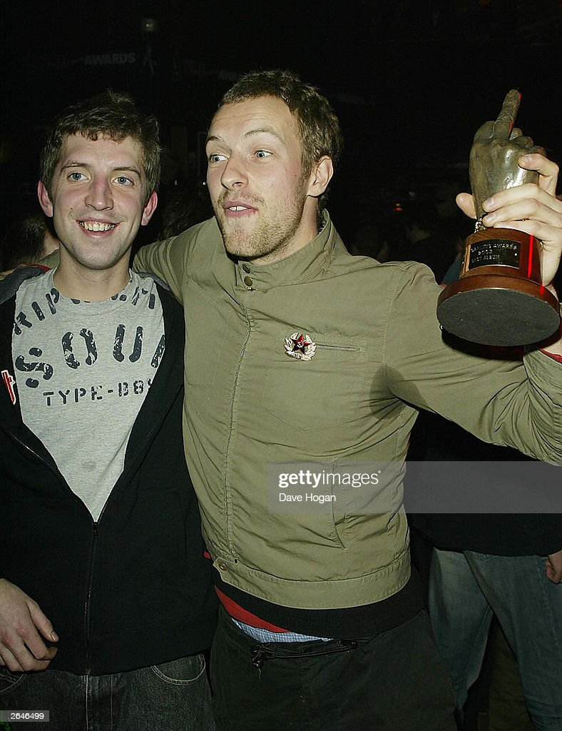 British singer Chris Martin of the pop group 'Coldplay' accepts the award for 'Album of the Year' for the album 'A Rush of Blood to the Head' at the NME Carling Awards at 'PoNaNa' in Hammersmith on February 13, 2003 in London.