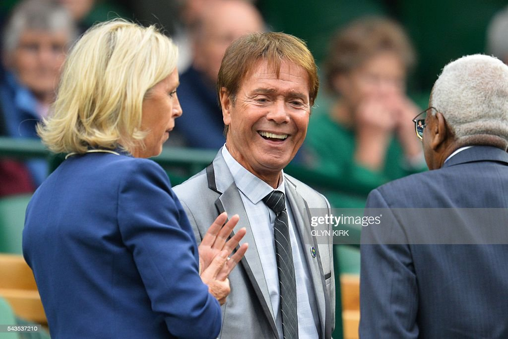 British singer Cliff Richard arrives in the royal box to watch Poland's Agnieszka Radwanska play against Ukraine's Kateryna Kozlova during their women's singles first round match on the third day of the 2016 Wimbledon Championships at The All England Lawn Tennis Club in Wimbledon, southwest London, on June 29, 2016. / AFP / GLYN