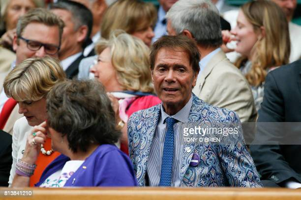 British singer Cliff Richard sits in the Royal Box on Centre Court for the women's singles semifinals on the tenth day of the 2017 Wimbledon...