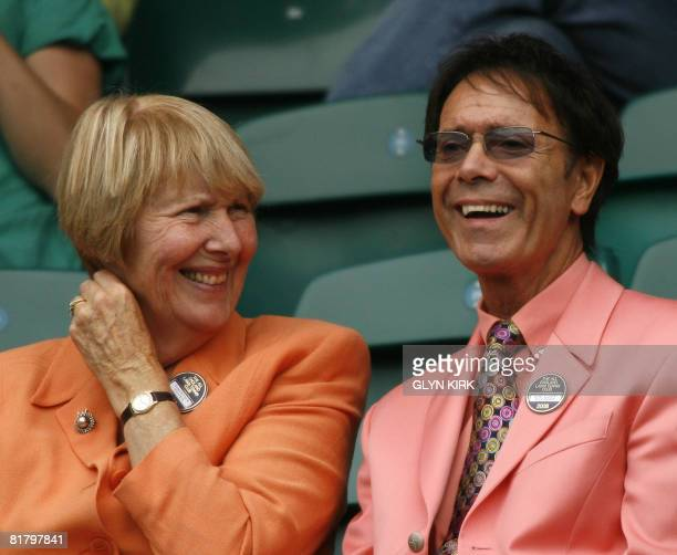 British singer Cliff Richard watches the tennis action on Centre Court between Mario Ancic of Croatia and Roger Federer of Switzerland in a Men's...