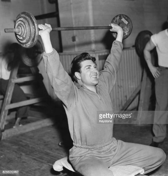 British singer David Hughes weightlifting at the YMCA HQ gymnasium in Great Russell Street London 28th March 1957