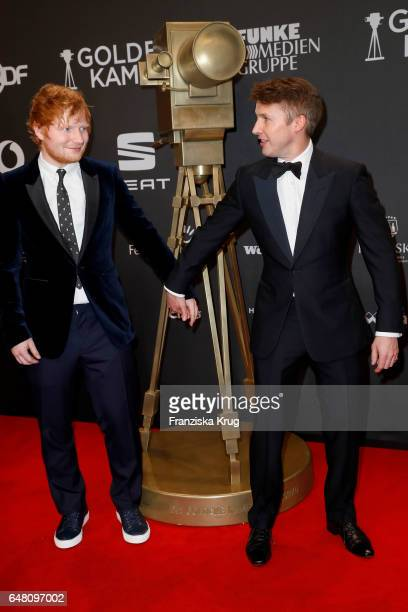 British singer Ed Sheeran and british singer James Blunt arrive for the Goldene Kamera on March 4 2017 in Hamburg Germany