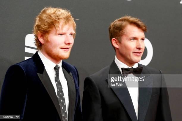 British singer Ed Sheeran and british singer James Blunt arrive for the Goldene Kamera on March 4 2017 in Hamburg Germany
