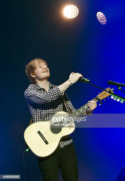 British singer Ed Sheeran performs live during a concert at the MaxSchmelingHalle on November 14 2014 in Berlin Germany