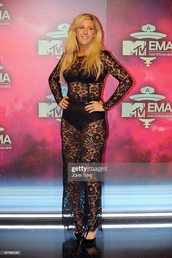 British singer Ellie Goulding poses as she arrives to attend the MTV European Music Awards (EMA) 2013 at the Ziggo Dome on November 10, 2013 in Amsterdam, The Netherlands.