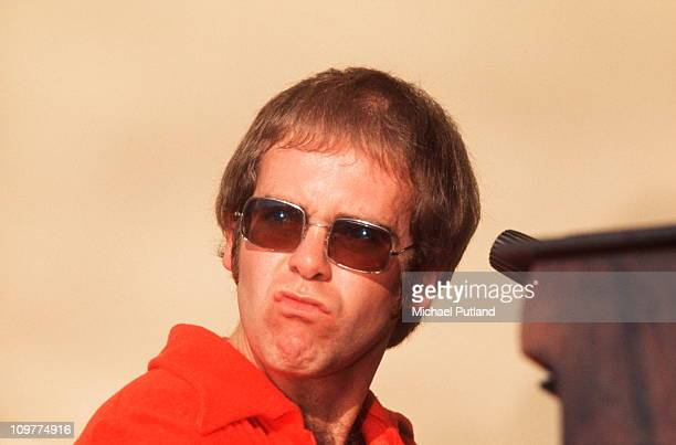 British singer Elton John performing on stage at the Crystal Palace Bowl in London England on July 31 1971