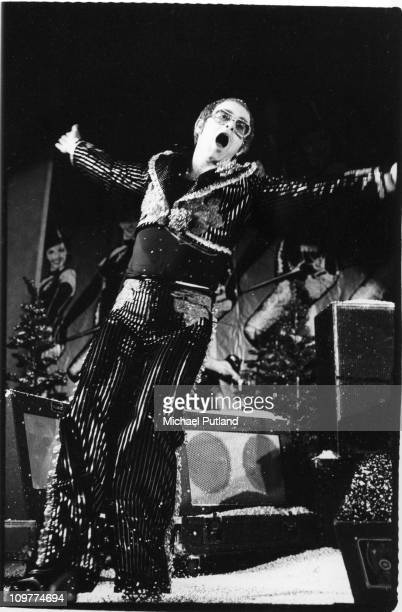 British singer Elton John performing on stage during his Christmas show at the Hammersmith Odeon in London England on December 24 1974