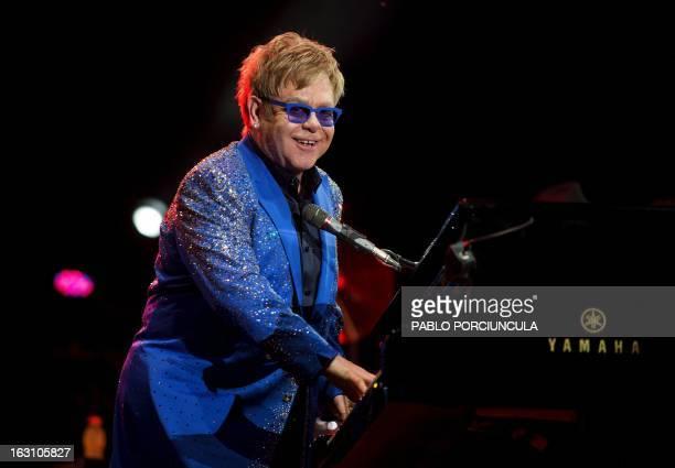 British singer Elton John performs at Gran Parque Central stadium in Montevideo on March 04 2013 AFP PHOTO/Pablo PORCIUNCULA