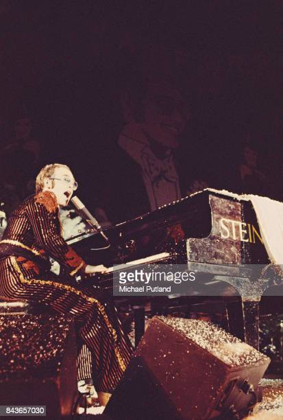 British singer Elton John performs on stage during his Christmas show at the Hammersmith Odeon in London UK 21st December 1973