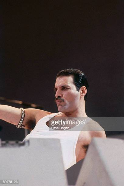 British singer Freddie Mercury performing with his rock band Queen during the Live Aid concert at Wembley Stadium in London 13th July 1985