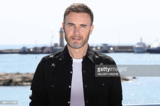 British singer Gary Barlow who stars in the series ''Let it Shine' poses during a photocall as part of the MIPTV event on April 3 2017 in Cannes...