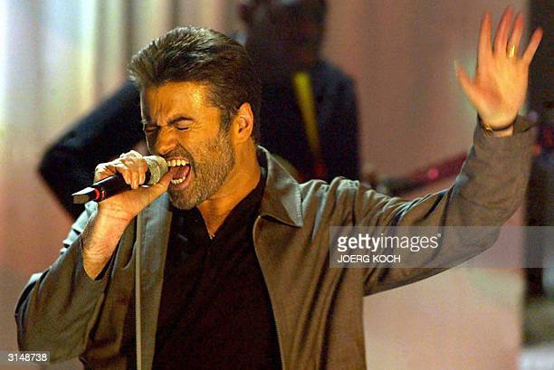 British singer George Michael performs at the German TV show 'Wetten Dass' during a live transmission in Basel late 27 March 2004 The show which has...