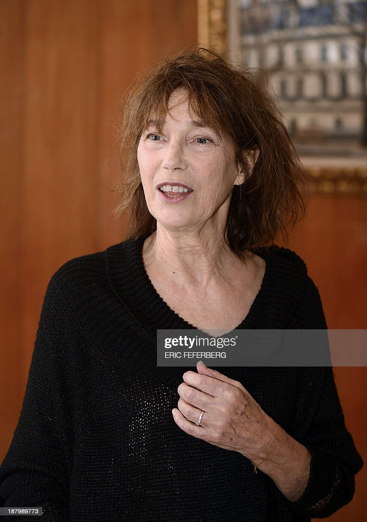 British singer Jane Birkin looks on after receiving a diploma from Japanese foreign minister for her support to Japan after the tsunami and the nuclear accident in 2011 on November 14, 2013 at the Japan embassy in Paris. AFP PHOTO ERIC FEFERBERG