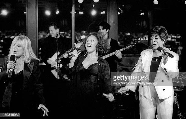 British singer Marianne Faithfull with American singers Darlene Love and Merry Clayton as they perform as part of the '20th Century Pop' concert at...