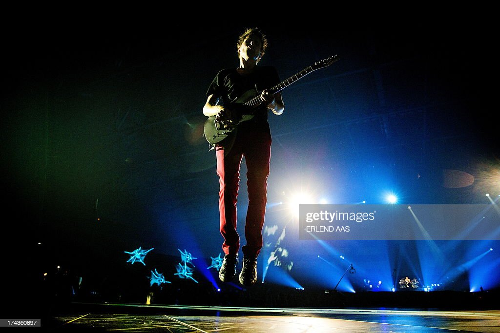 British singer Matthew Bellamy perfoms on stage with his band Muse on July 24, 2013 at Telenor Arena in Oslo. AFP PHOTO / NTB SCANPIX / ERLEND AAS