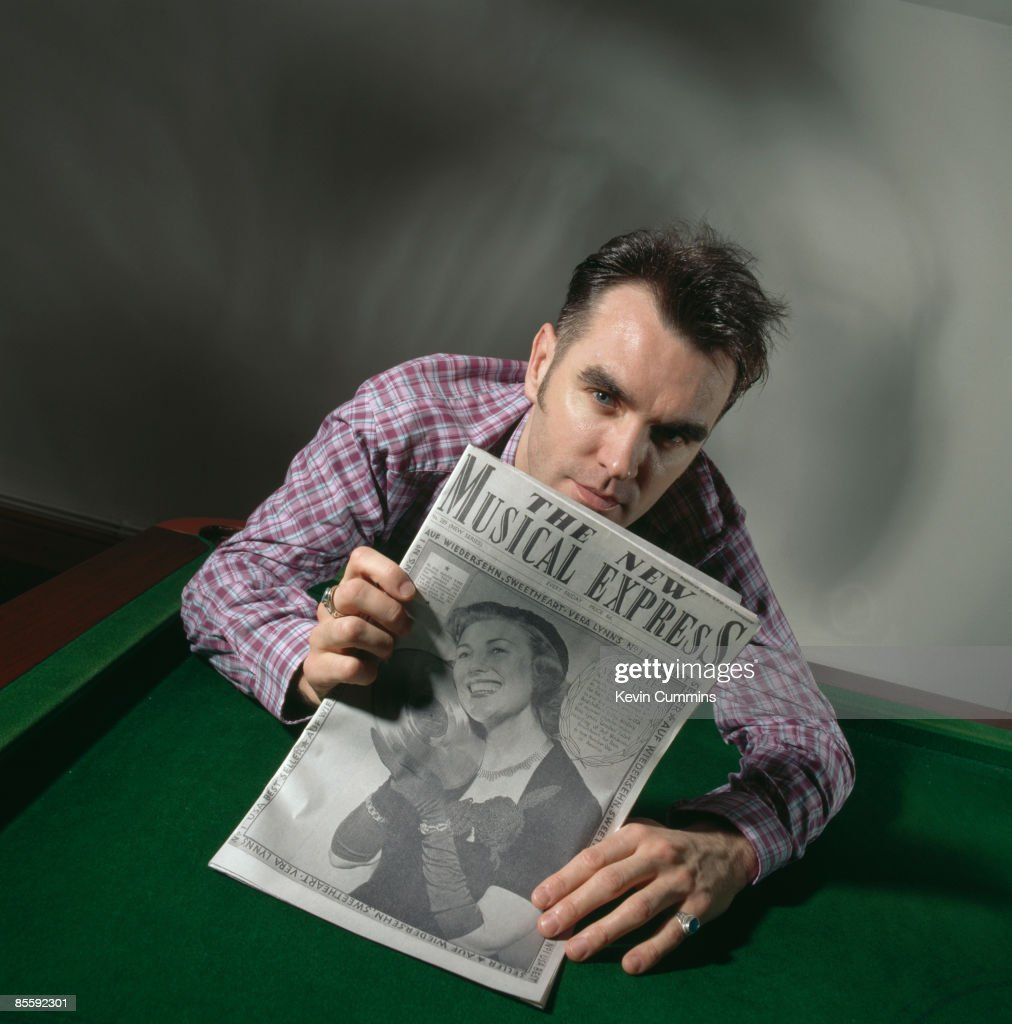 British singer Morrissey holds a 1952 copy of 'The New Musical Express' magazine to celebrate the 40th anniversary of the publication 24th March 1992...
