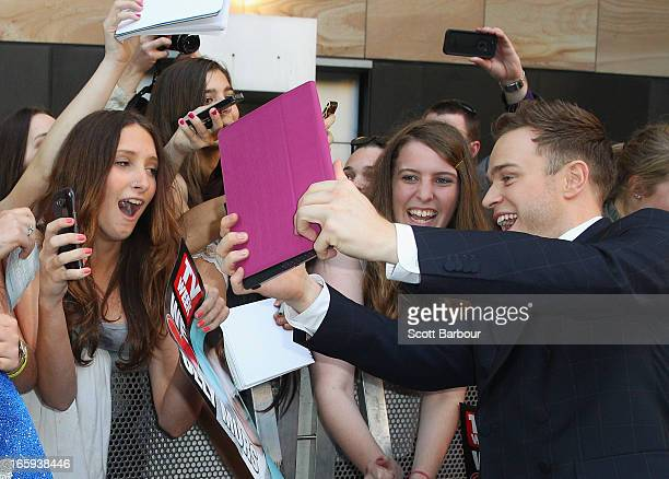 British singer Olly Murs poses for a photo with a fan as he arrives at the 2013 Logie Awards at the Crown on April 7 2013 in Melbourne Australia