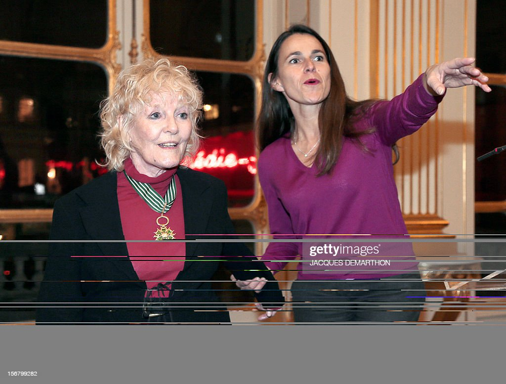 British singer Petula Clark (L) listens to French Culture Minister Aurelie Filippetti (R) after been awarded Commander in the Order of Arts and Letters during a ceremony at the ministry in Paris, on November 21, 2012. DEMARTHON