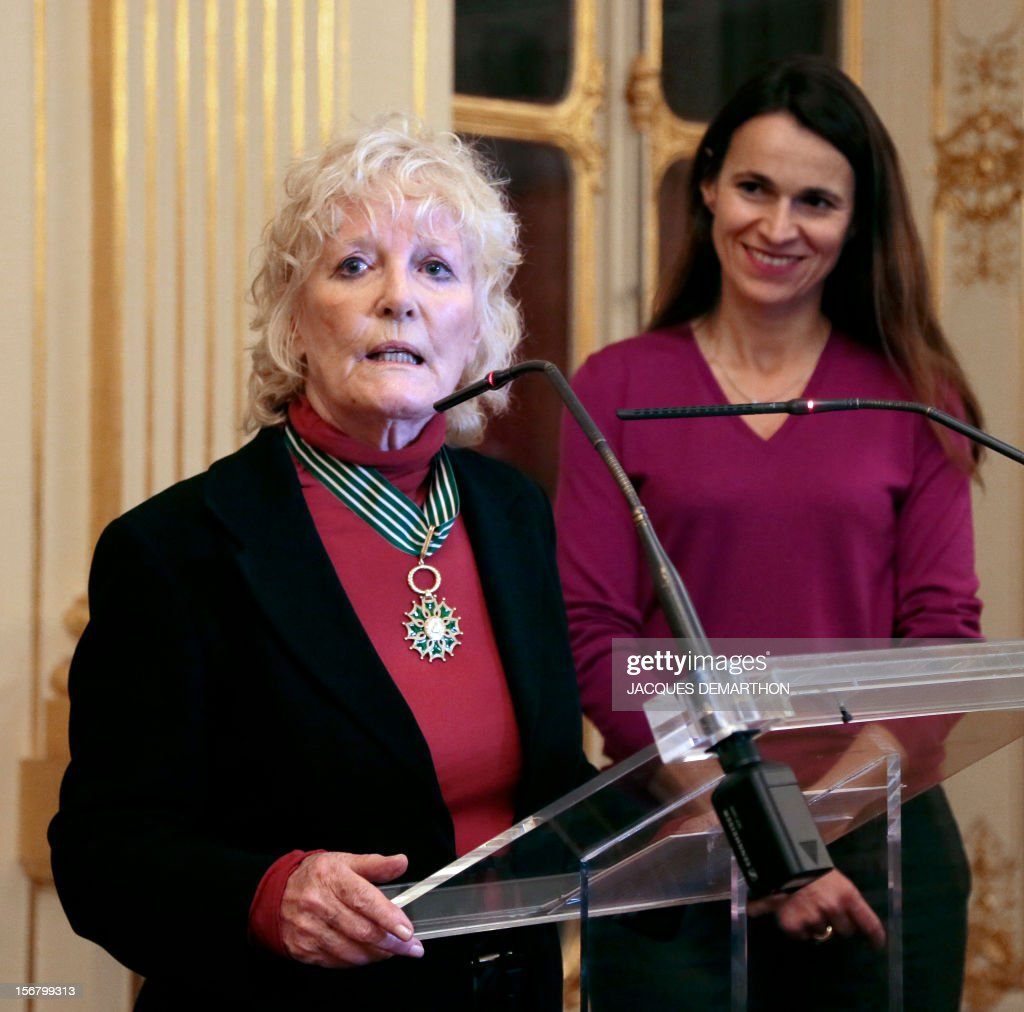 British singer Petula Clark (L) thanks after been awarded Commander in the Order of Arts and Letters by French Culture Minister Aurelie Filippetti during a ceremony at the ministry in Paris, on November 21, 2012. DEMARTHON
