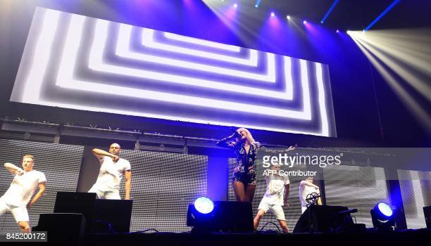 British singer Pixie Lott performs during the 'We Are Manchester' charity concert at the Manchester Arena in Manchester northwest England on...