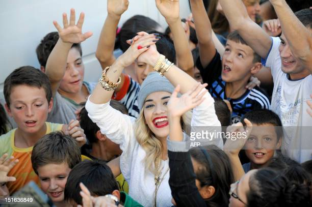 British Singer Rita Ora gestures during the filming of her new music video in Pristina on September 9 2012 Ora arrived in Kosovo on September 7 to...