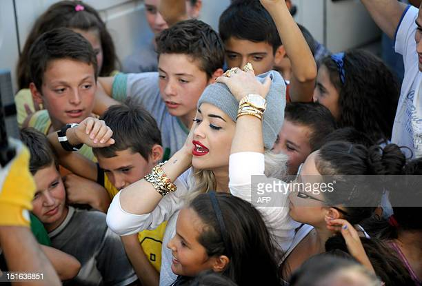 British Singer Rita Ora reacts during the filming of her new music video in Pristina on September 9 2012 Ora arrived in Kosovo on September 7 to film...