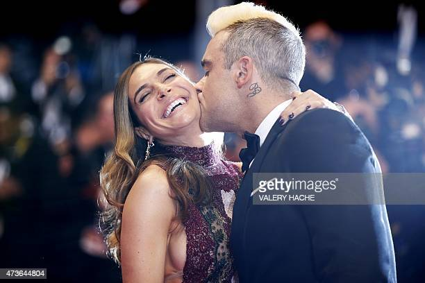 British singer Robbie Williams kisses his wife Ayda Field as they arrive for the screening of the film 'The Sea of Trees' at the 68th Cannes Film...