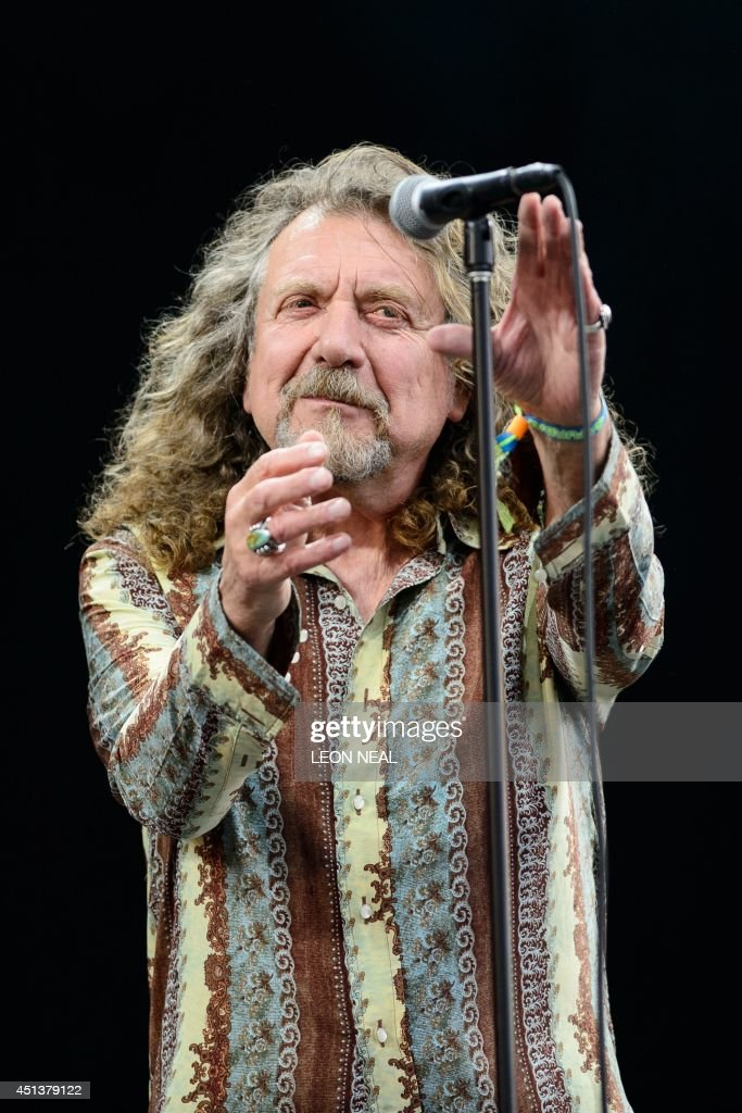 British singer Robert Plant performs on the Pyramid Stage, on the second day of the Glastonbury Festival of Music and Performing Arts in Somerset, southwest England, on June 28, 2014. US metal giants Metallica will play this year's coveted Saturday night headline spot at Britain's Glastonbury festival, organisers announced Thursday. It will be the 'Master of Puppets' four-piece's first appearance at the legendary festival, held in south west England, following on from The Rolling Stones' Worthy Farm debut last year. AFP PHOTO / LEON NEAL