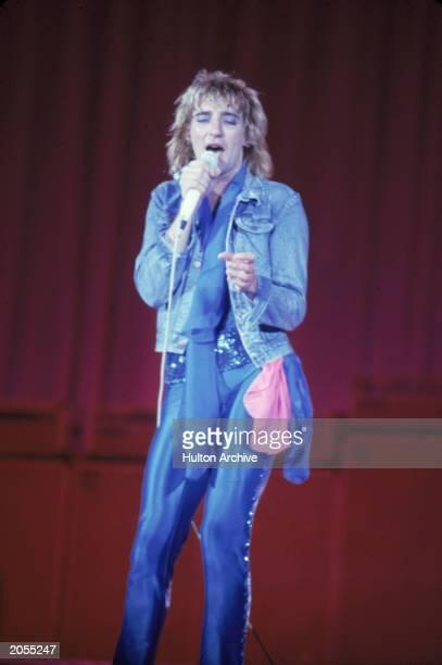 British singer Rod Stewart performs in tight blue satin pants and blue eyeshadow circa 1978