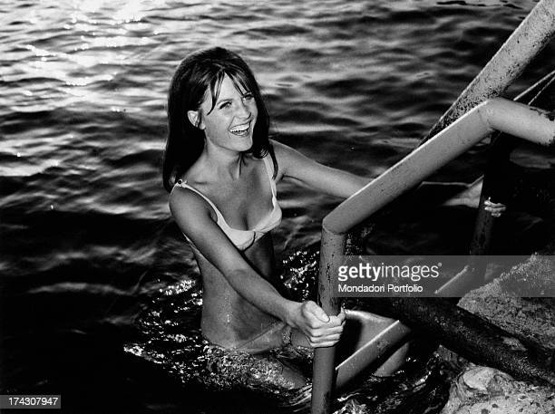 British singer Sandie Shaw coming out from the water climbing a ladder 1967