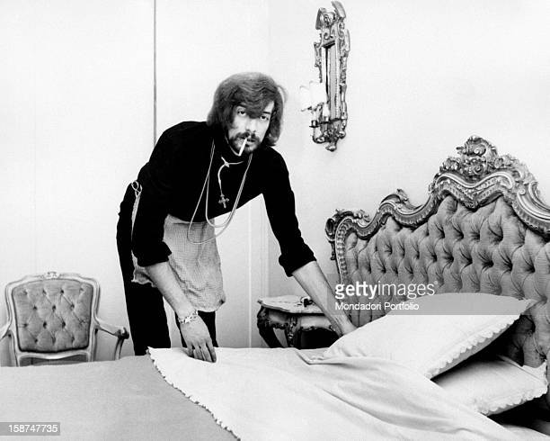 British singer Shel Shapiro member of the English band The Rokes making the bed with a cigarette in his mouth Rome 1968