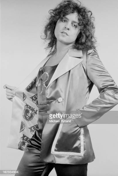 British singer songwriter and musician Marc Bolan modelling a satin jacket with a TRex print lining London 1973